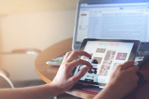 Image of someone using a tablet search